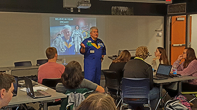 photo of astronaut speaking to students.