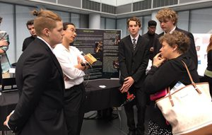 Photo of students presenting a design project.