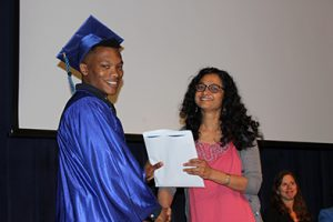 Photo of student receiving a diploma at graduation.