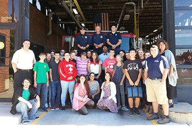 Photo of TVHS students in front of fire truck.
