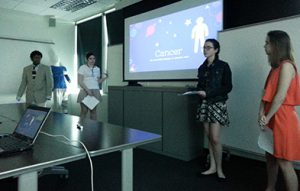 Photo of students presenting research to class