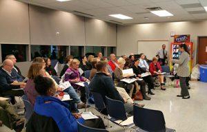 Photo of educators listening to a presentation.