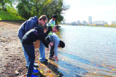 Photo of students collecting water at the Hudson River