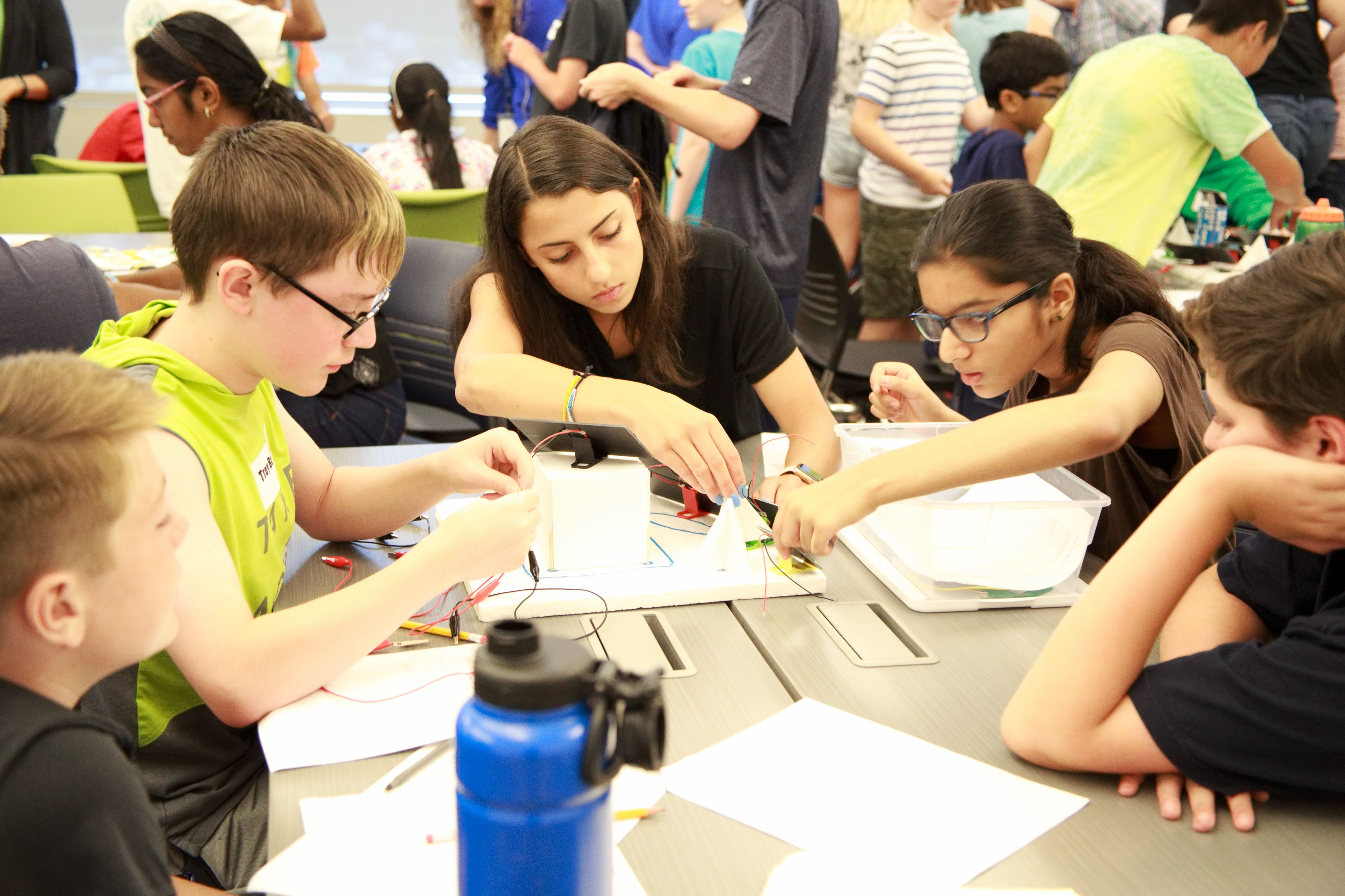 photo of students working on a group activity around a table