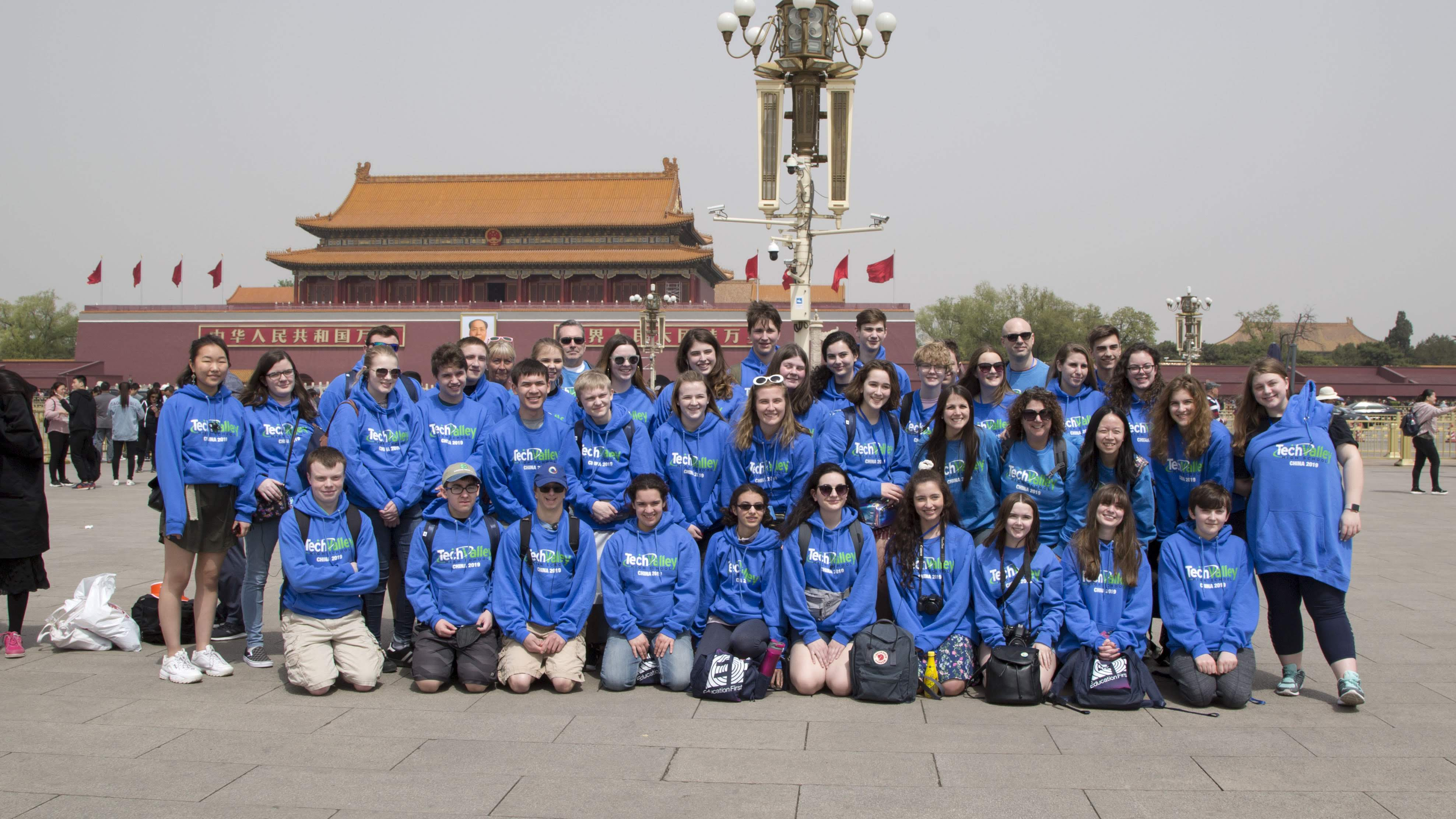 Group photo of TVHS staff and students outside the forbidden city in China