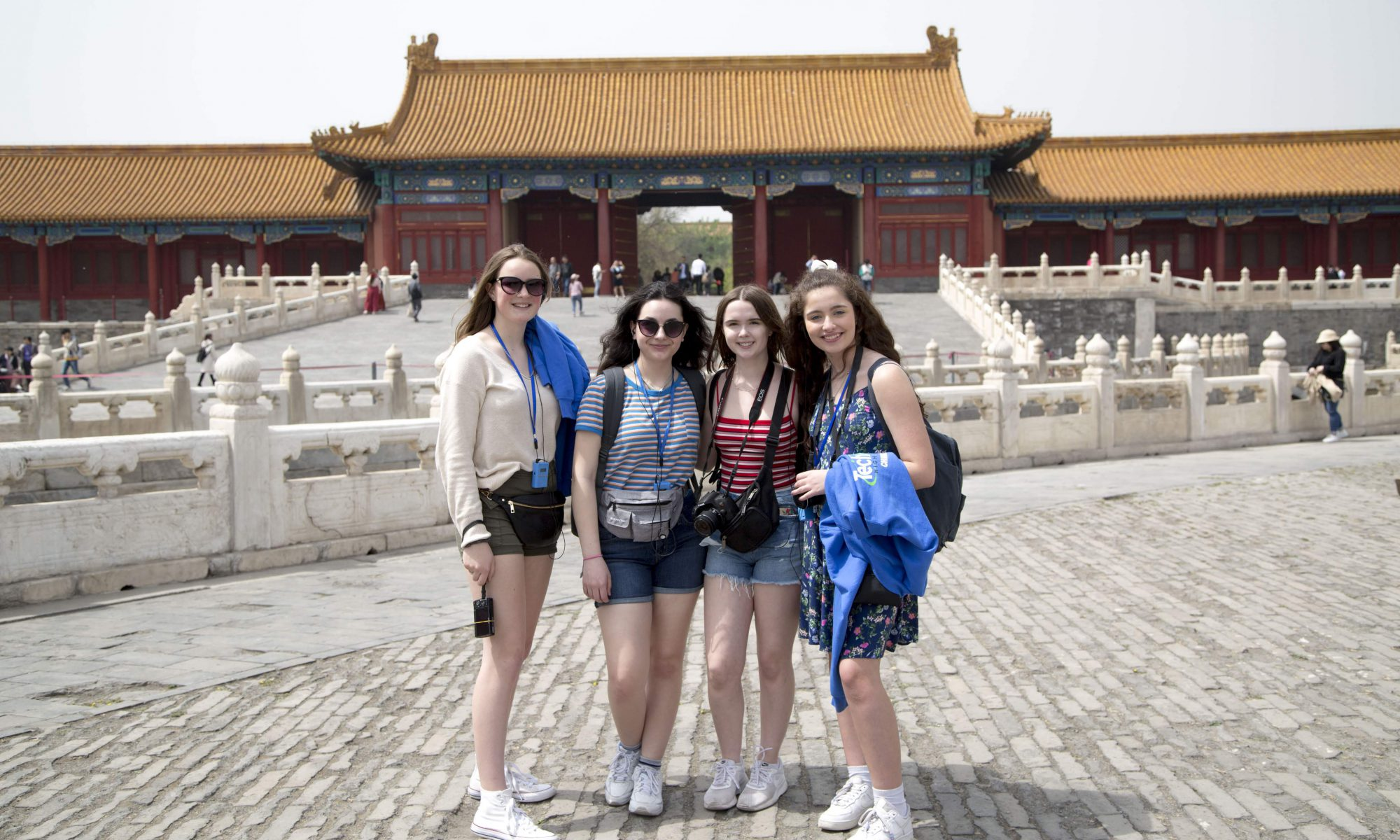 Photo of four students in China